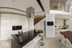 Panoramic photo of elegant kitchen connected with dining hall
