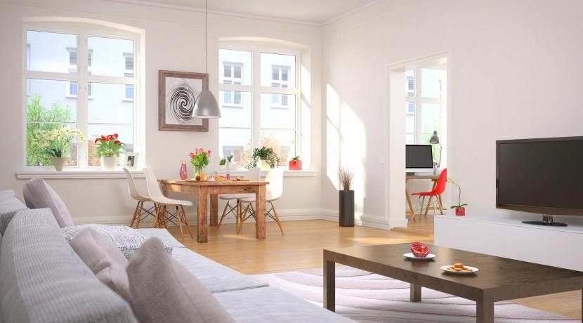 Wohnzimmer und Esszimmer mit einem gedeckten Frhstckstisch